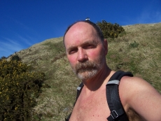 Alistair McAlpine, Web Writer with backpack in the hills