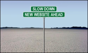A signpost reading Slow down, new website ahead